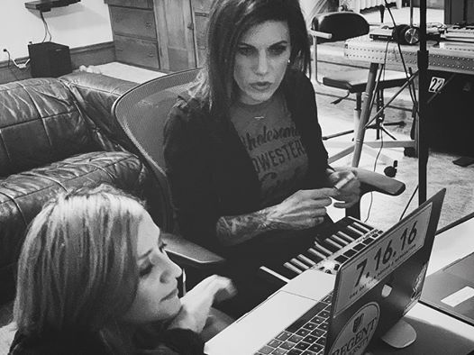 Korey Cooper and Lacey Sturm at a laptop